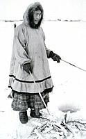 Eskimo Woman Ice Fishing for Tom Cod