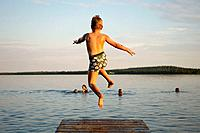 7 year old boy and jumping from a jetty, Norrbotten, Sweden (July 2005)