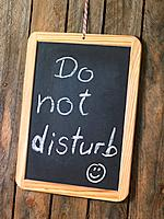 Do Not Disturb sign on blackboard