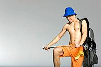 Young man breaking golf club, studio shot (thumbnail)