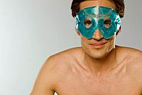 Mid adult man wearing eye mask (thumbnail)