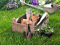 Close_up of gardening equipments in a lawn