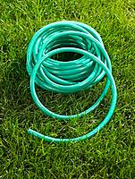 High angle view of a rolled up garden hose
