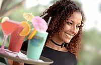 African American Waitress Holding Tray of Tropical Beverages (thumbnail)