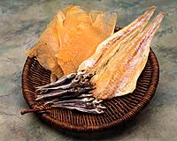 Closed Up Image of Several Dried Fish in a Wooden Basket, High Angle View