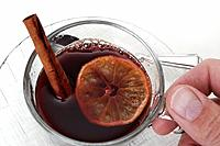 Mulled wine with orange slice and cinnamon stick