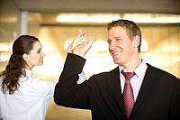 A Pair of Office Workers Touching Each Other´s Hands, Front View, Rear View, Head and Shoulders, Differential Focus