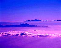a Sea of Clouds With Several Mountaintops Showing, High Angle View, Soft Focus
