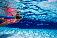a Woman Snorkeling in the Maldivian Ocean, Surrounded By Fish, Side View, Maldives, Micronesia