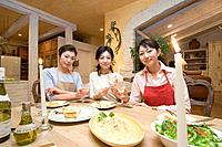 Three Mid Adult Women Eating a Meal
