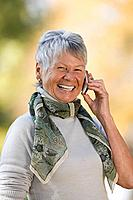 Smiling senior woman using a cell phone