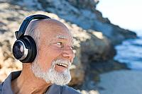 Senior man listening to music (thumbnail)
