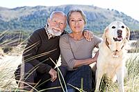 Senior couple with a pet dog