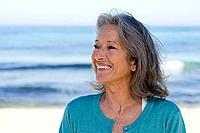 Smiling senior woman on beach