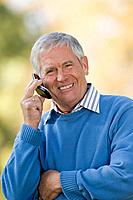 Senior man using a cellular telephone