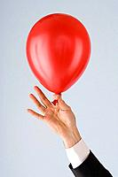 Person holding a balloon
