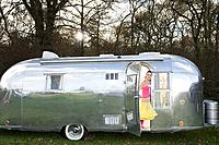 A teenage girl in a caravan