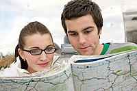 Teenage couple with a map