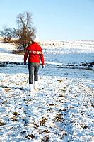 Woman walking on snowy ground