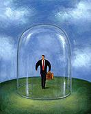 Businessman standing within a glass dome