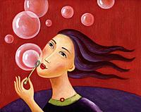 Closeup of a woman blowing bubbles