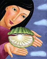Closeup of a woman holding an oyster with a pearl inside