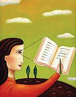 Profile of a woman writing in a journal