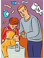 Man putting cream on childs knee injury, with first aid items in background