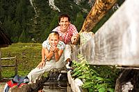 Austria, Salzburger Land, couple drinking water