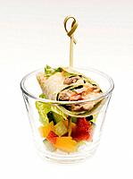 Turkey wrap with vegetable in glass