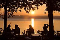 Germany, Bavaria, Ammersee, beergarden at sunset