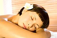 Young woman lying in spa, eyes closed