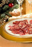 Iberian acorn hand_sliced ham in Christmas arrangement