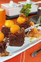 Walnut brownie with caramel_coated kaki persimon small balls