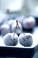 Two sugar_covered cherries