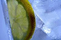 Glass with ice and lemon slice detail