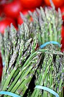 Green asparagus bunches on sale at the market place