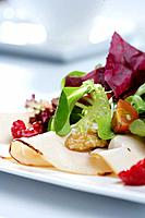 Chiken salad with red fruit and nuts