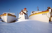 Fishing boats and Lighthouse in winter, North Rustico, Prince Edward Island, Canada