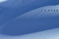 A group traveling across the Durrand Glacier, Revelstoke, British Columbia, Canada.