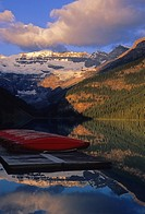 Lake Louise and canoes in the early morning at sunrise Banff National Park, Alberta, Canada.