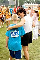 Mom congratulating son after winning medal in track event, Special Olympics, U of M Bierman Field, Minneapolis, Minnesota, USA