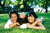 Young Japanese family posing together.