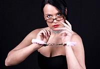 symbolic for dominatrix, sexy woman with handcuffs