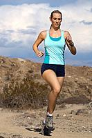 Young woman jogging in mountains