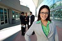 Portrait of businesswoman in front of office building