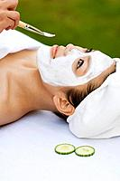 Young woman having facial treatment close_up
