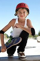 Teenage boy 13_15 with skateboard at skateboard park portrait