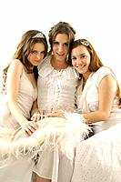 Portrait of three young women sitting together