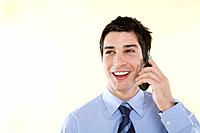 Smiling businessman with cell phone